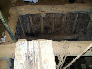 The inside of a mine. To prevent the mine collapsing, a wooden structure is used.